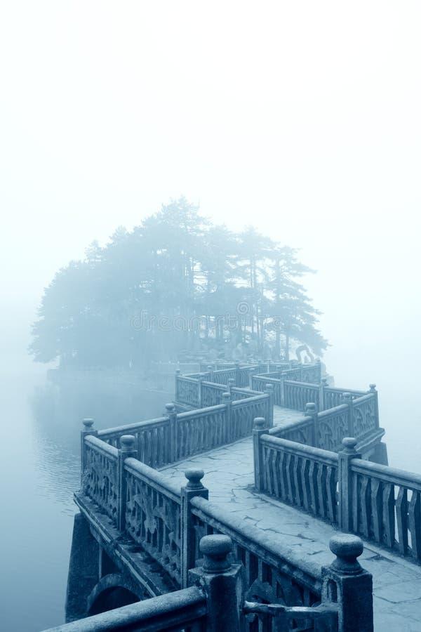 Zigzag bridge and fog. Fog and zigzag bridge in the lake stock photos
