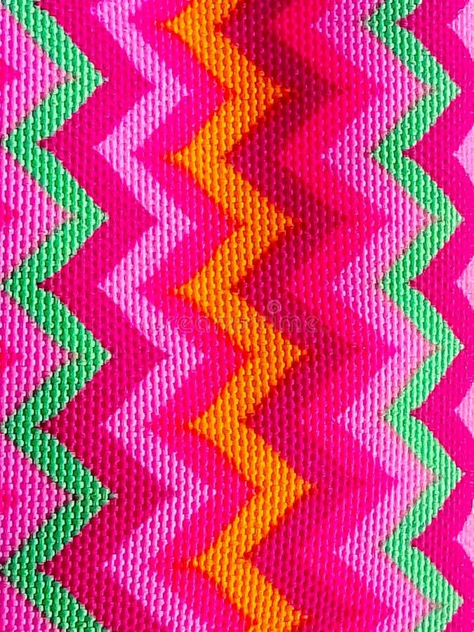 Zigzag lumineux sur le modèle de tissu photos stock