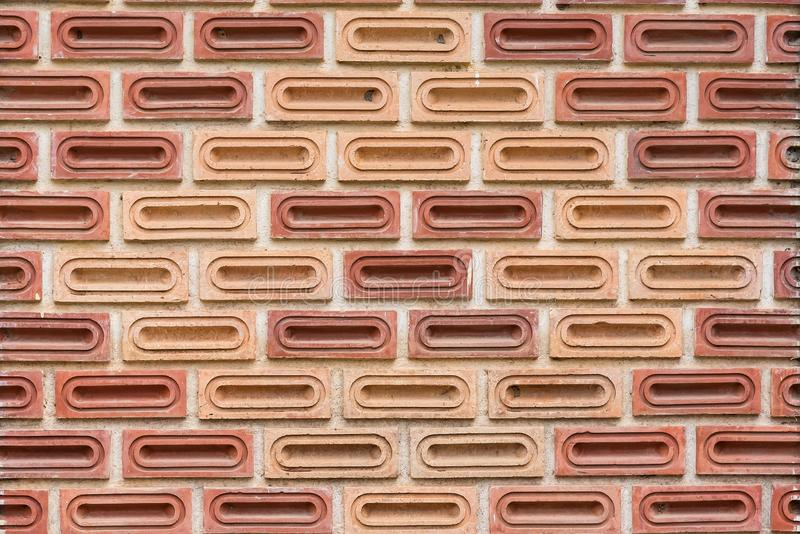 The zigzag position with oval pattern of brickwall texture. Old, red, construction, brown, background, exterior, block, backdrop, concrete, brickwork, grunge stock photo