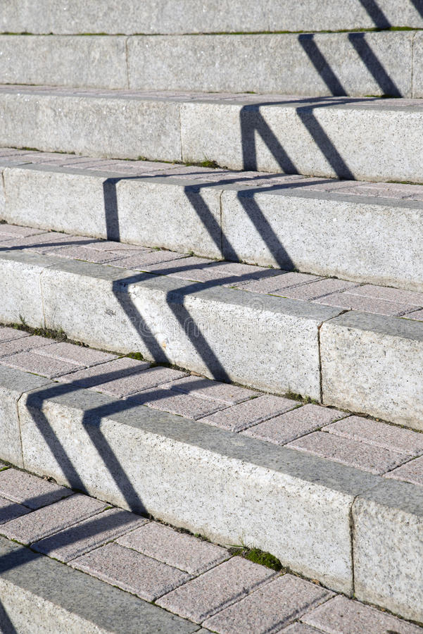 Zigzag. Shadow and light makes zigzag pattern on stone stairs royalty free stock photography