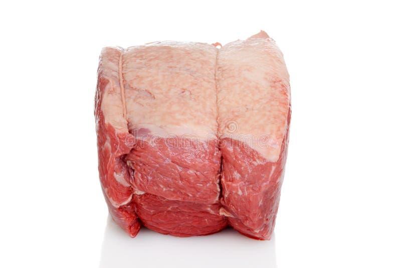 Zijaanzicht buiten rond rundvleesbraadstuk stock foto