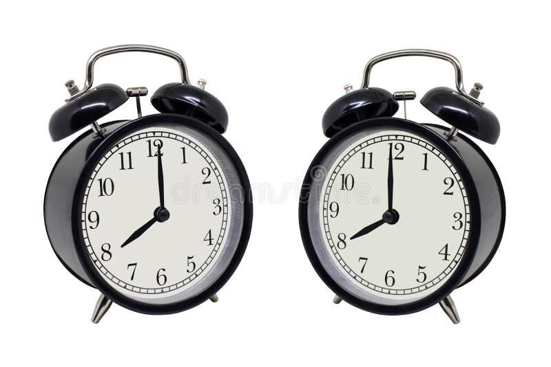 Zijaanzicht retro zwarte wekker die acht die uur tonen op witte achtergrond worden ge?soleerd royalty-vrije stock fotografie