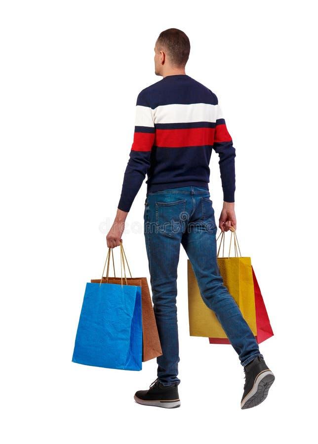 Zijaanzicht van de gaande mens met het winkelen zakken stock afbeeldingen
