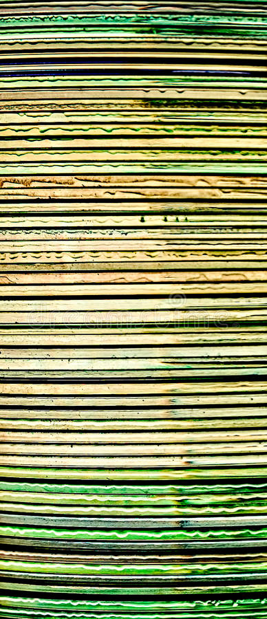 Zijaanzicht van een bos van compact-discs stock afbeelding