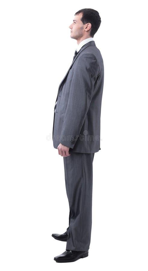Zijaanzicht van ernstige zakenman met gekruiste handen op wit royalty-vrije stock foto's