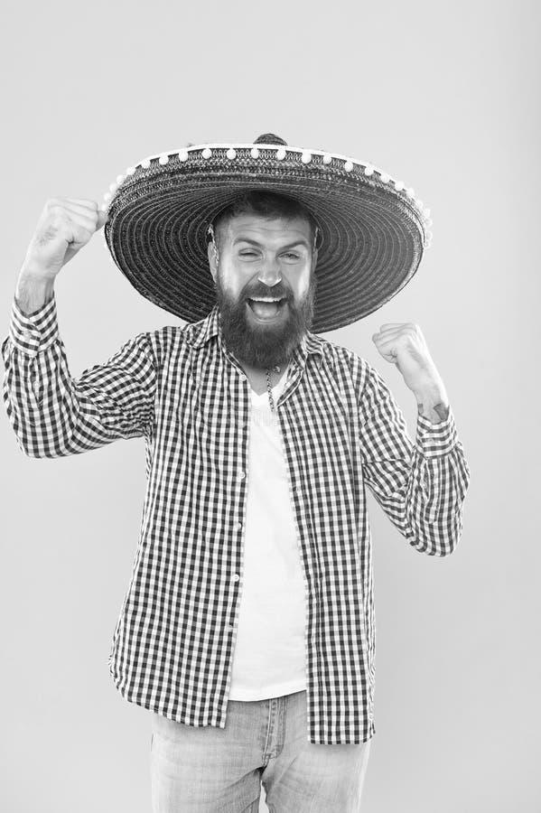 Zijn hartstocht is aan partij Mexicaanse mens die sombrero dragen Hipster in brede randhoed Gebaarde mens in Mexicaanse hoed trad stock fotografie