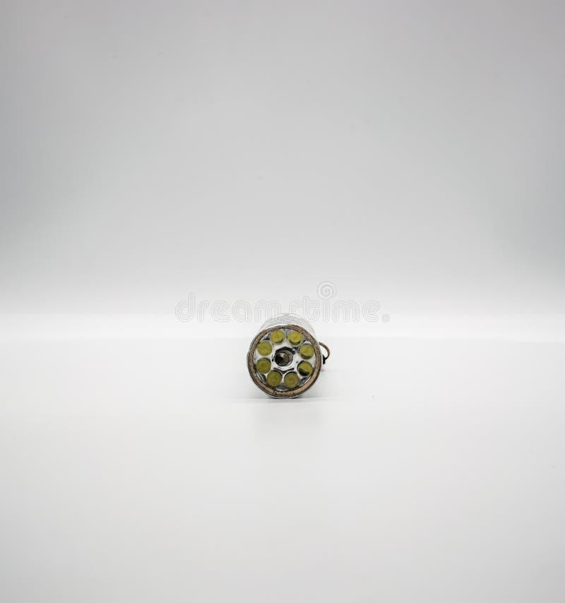 Zilveren die metaalflitslicht op witte achtergrond wordt geïsoleerd royalty-vrije stock foto