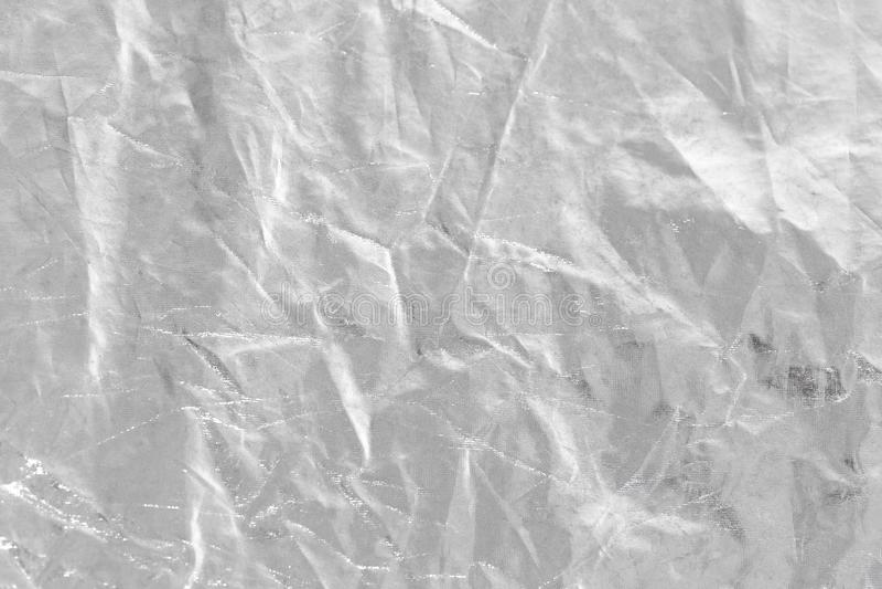 Zilveren folieachtergrond met glanzende verfrommelde ongelijke oppervlakte voor te royalty-vrije stock fotografie