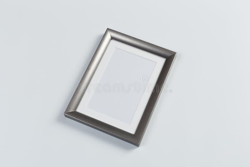 Zilveren kader op wit stock fotografie