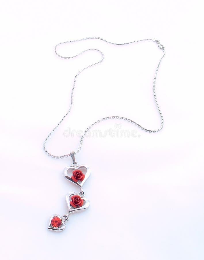 Zilveren ketting met liefde royalty-vrije stock afbeelding