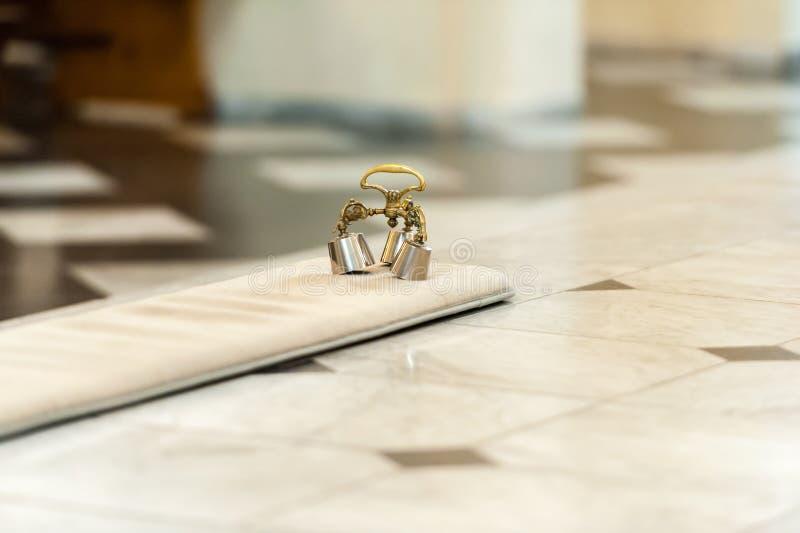 Zilveren klokken in kerk voor ceremonie royalty-vrije stock foto