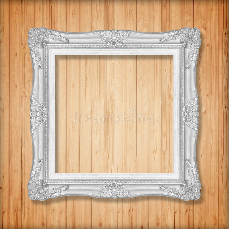 Zilveren omlijsting op houten muur royalty-vrije stock fotografie
