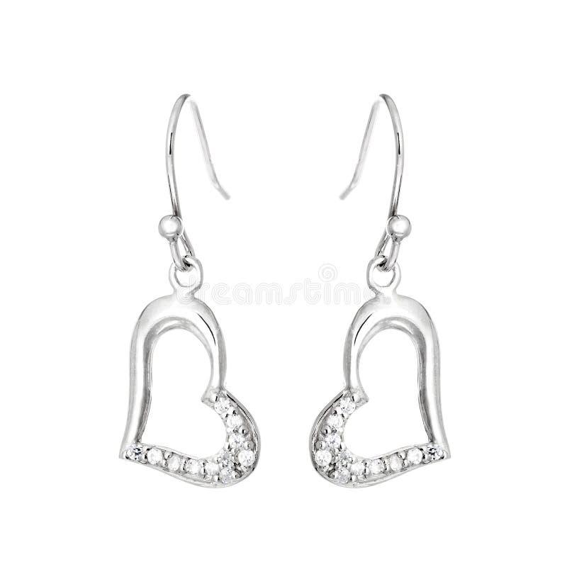 Zilveren oorringen in de vorm van hart stock afbeelding
