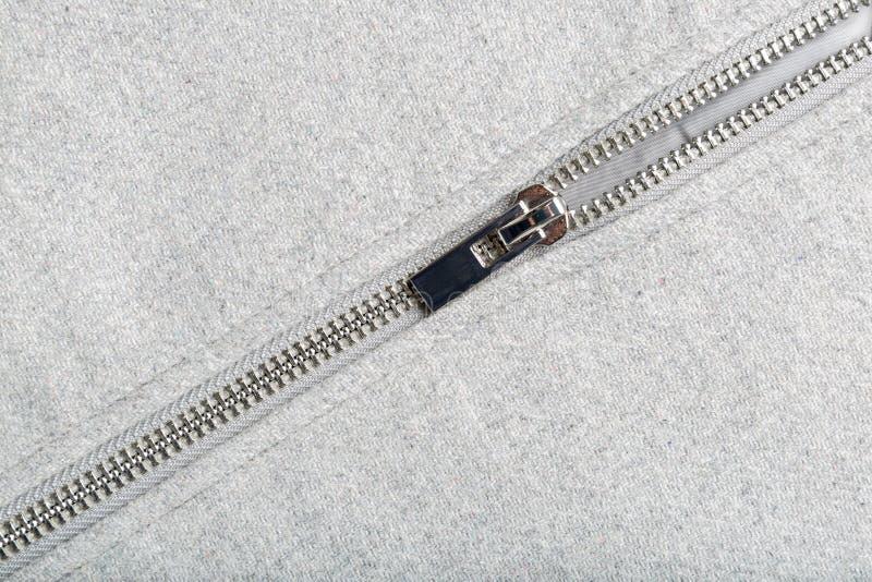 Zilveren pit op wollen stof royalty-vrije stock afbeelding
