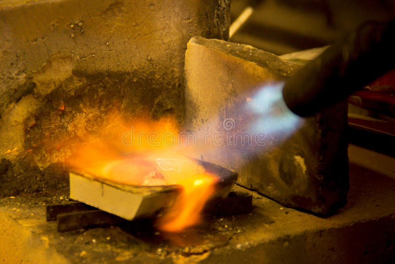 Zilveren smelting, stock foto