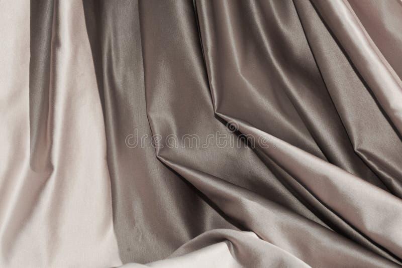 Zilveren stoffenvouwen, achtergrond royalty-vrije stock fotografie