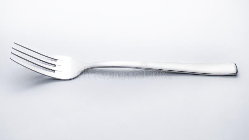 Zilveren vork op witte achtergrond stock foto's