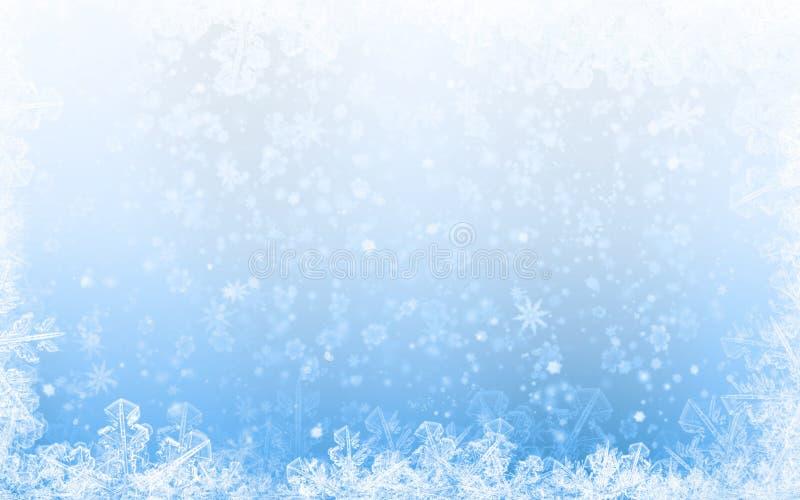 Zima wakacji tła błękit z płatek śniegu obrazy stock