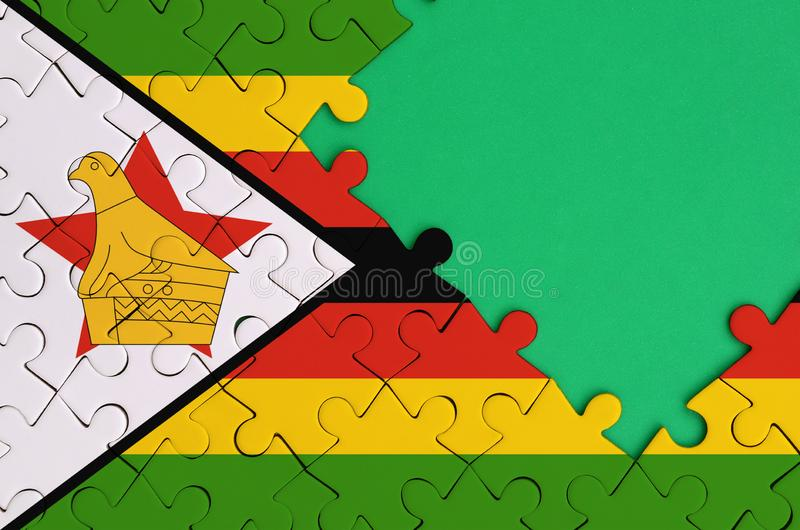 Zimbabwe flag is depicted on a completed jigsaw puzzle with free green copy space on the right side vector illustration