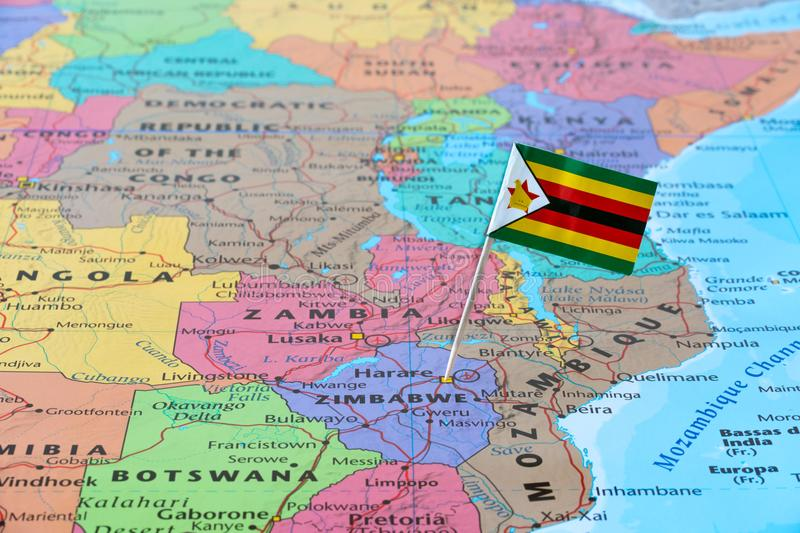 Zimbabwe map and flag pin. Zimbabwe paper flag pin on a map. Officially the Republic of Zimbabwe is a landlocked country located in southern Africa stock images