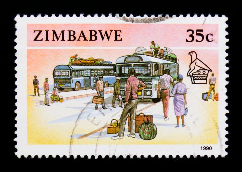 Zimbabwe postage stamp shows Buses and Passangers, Animals, Hand Crafts and Transportation serie, circa 1990. MOSCOW, RUSSIA - SEPTEMBER 3, 2017: A stamp printed stock photography