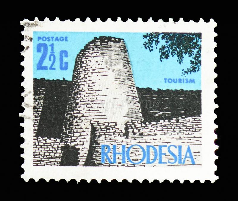 Zimbabwe ruins, New Currency Definitives serie, circa 1970. MOSCOW, RUSSIA - FEBRUARY 10, 2019: A stamp printed in Rhodesia shows Zimbabwe ruins, New Currency royalty free stock image