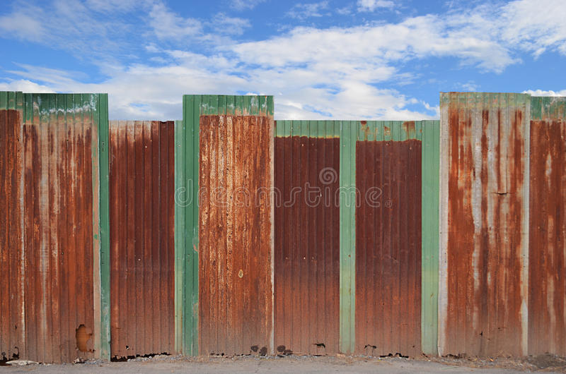 Zinc fence on blue sky royalty free stock photos