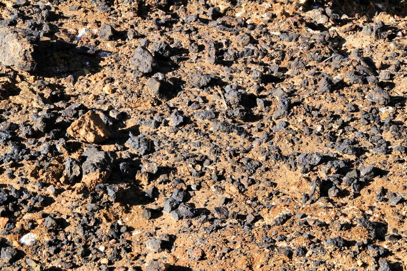 Zinc and lead minerals on the floor. Of an old abandoned quarry in Mazarron monotone ballast macadam refracted texture crushed background gravel small rock stock image