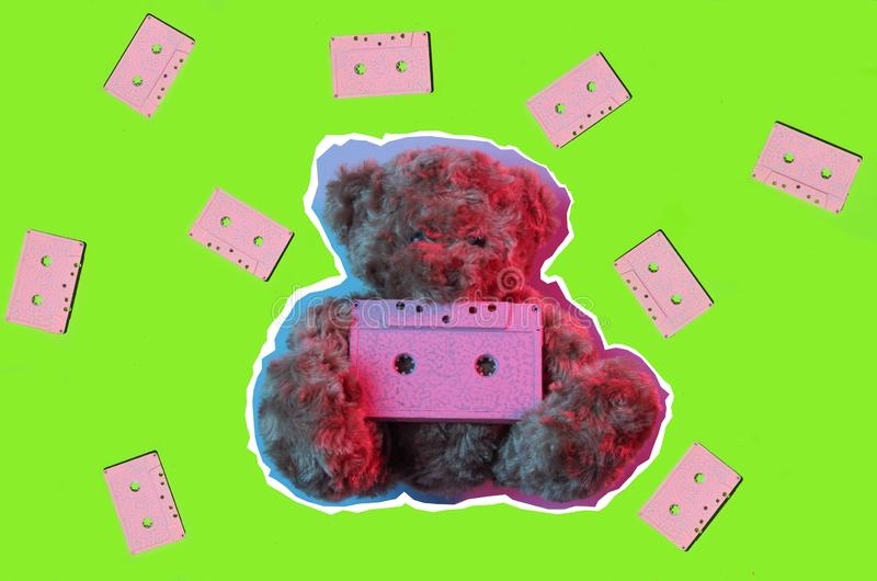 Zine style, pop art design. Creative collage teddy bear hold audio cassette  in red blue neon light. Top view. Retro style 80s stock photo