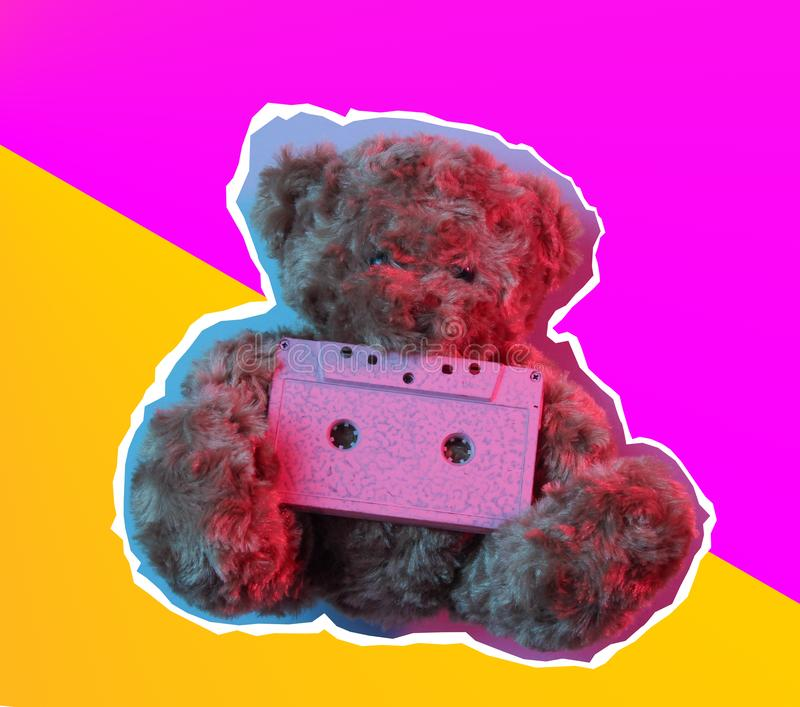 Zine style, pop art design. Creative collage teddy bear hold audio cassette  in red blue neon light. Top view. Retro style 80s stock photography