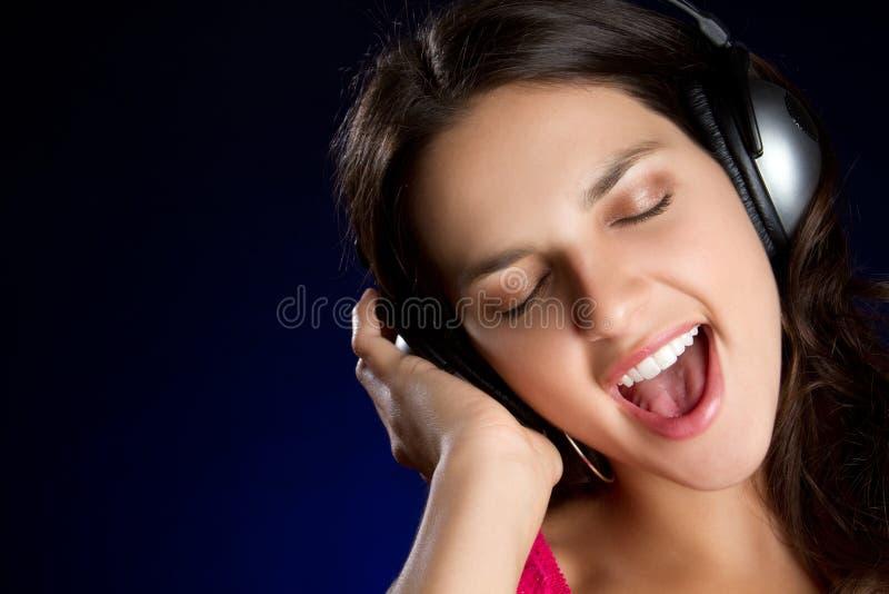 Zingende Tiener stock afbeelding