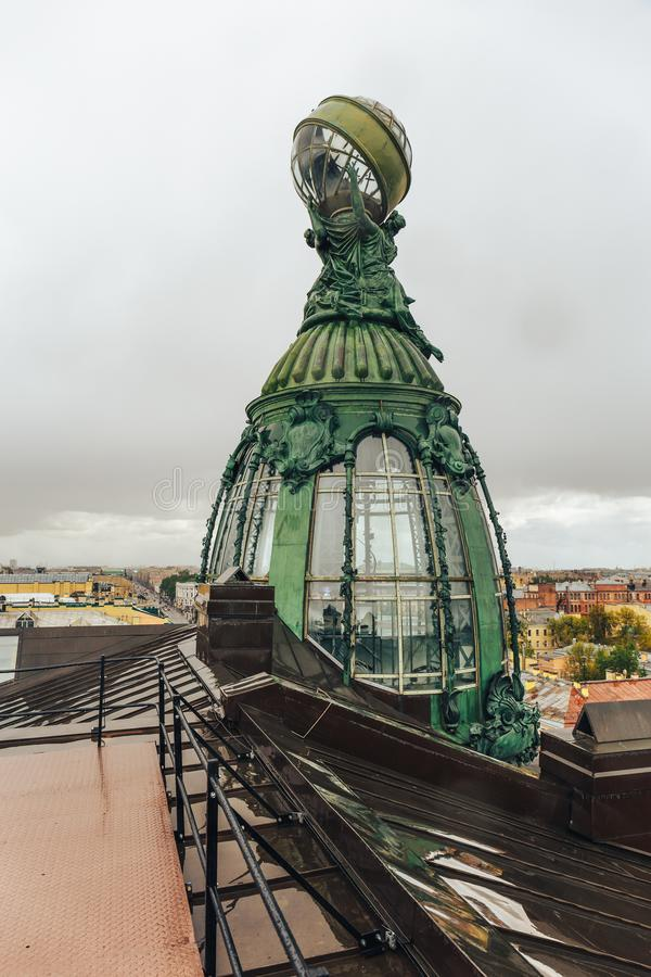 Zinger House - famous building in St. Petersburg on Nevsky prospect, view to bronze tower from roof. Vertical image stock image