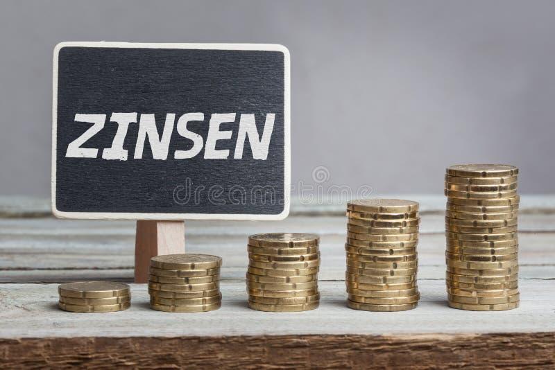 Zinsen-Interessen auf Deutsch stockbilder