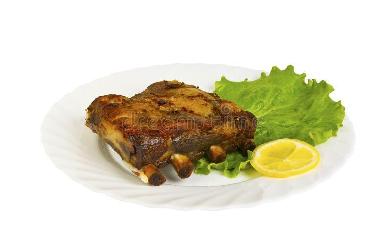 Ziobro dziki knur piec na grillu na talerzu, odosobnionym obraz royalty free