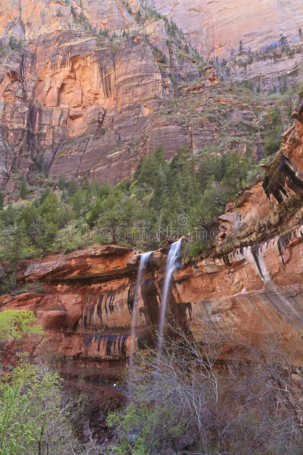 Zion Red Cliff Waterfalls. Three waterfalls spill over red cliffs at Lower Emerald Pools in Zion National Park, Utah royalty free stock images