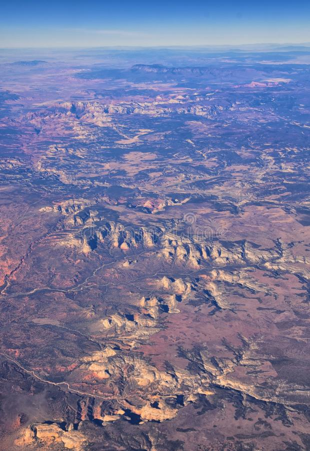 Zions National Park in Utah, Aerial view from airplane of abstract Landscapes, peaks and canyons by Saint George, United States of stock image