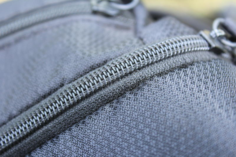 Zip of Bag. Black colored zip of a backpack bag stock photo
