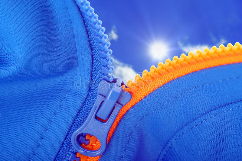 Zip jacket from the sky. Open from zip jackets in jackets sunny sky royalty free stock photo
