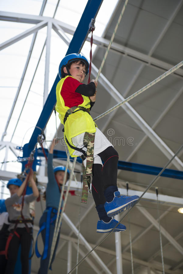 Zip line and climbing training indoors royalty free stock photography