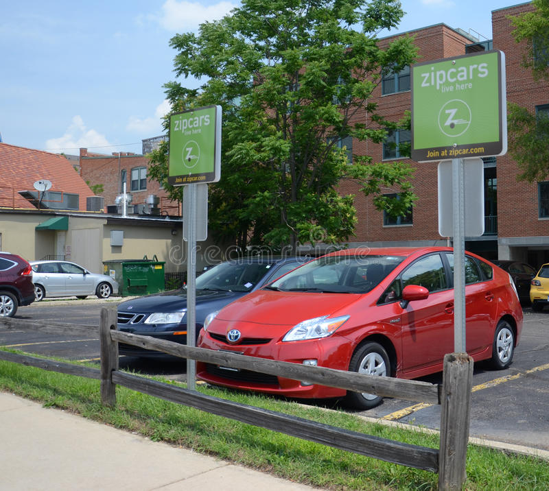 Zipcar lot in Ann Arbor. ANN ARBOR, MICHIGAN - JUNE 21: Zipcar, with cars available at locations such as the one shown here on June 21, 2013, was purchased by