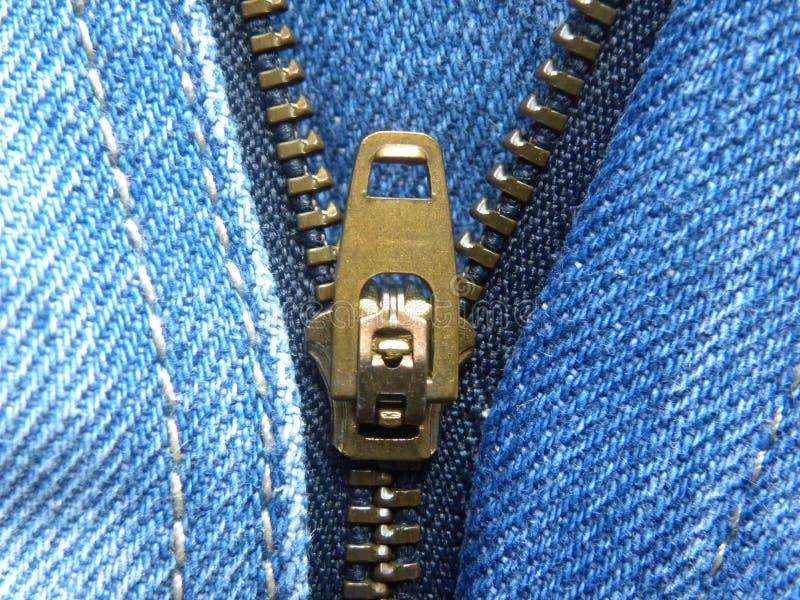 Zipper on blue jeans stock photo