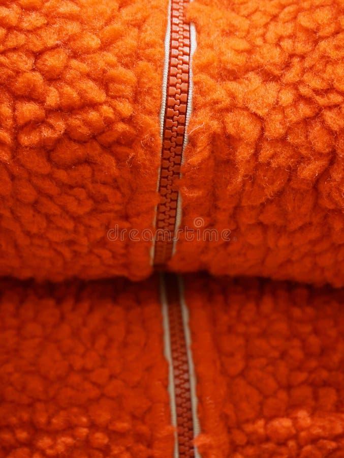 Zipper on orange wool texture background stock photography