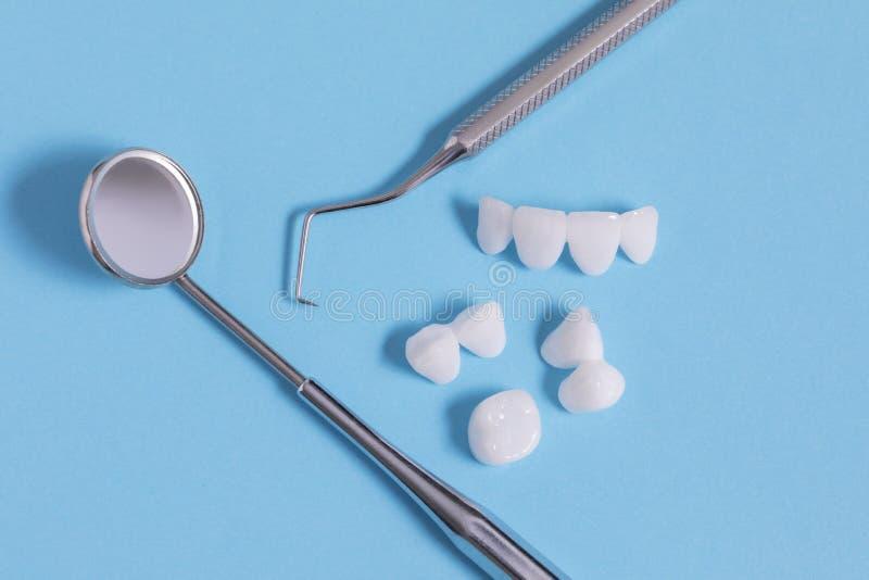 Zircon dentures , dental tools - Ceramic veneers - lumineers stock photo