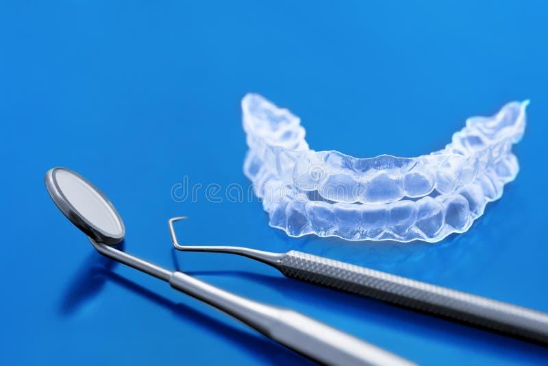 Dental tools and zircon dentures - Ceramic veneers - lumineers stock image