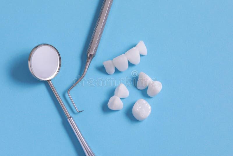 Zircon dentures , dental instruments - Ceramic veneers - lumineers royalty free stock images