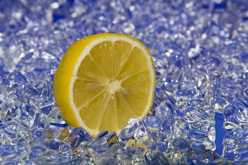 Citron on ice. Fresh halfed citron on cold ice royalty free stock images