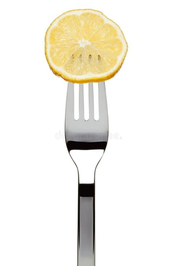 Zitronescheibe sticked auf Gabel stockbilder