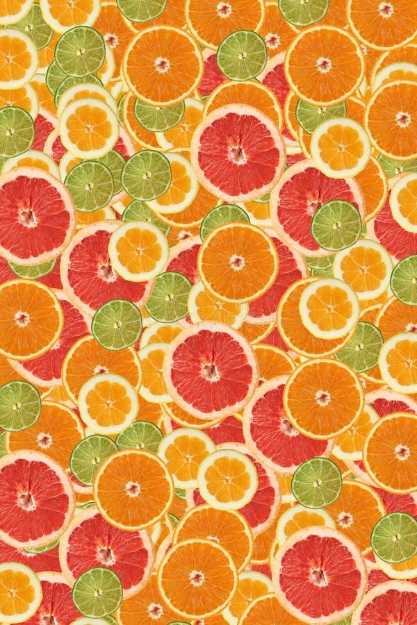 Zitrusfruchtscheibehintergrund stockbild