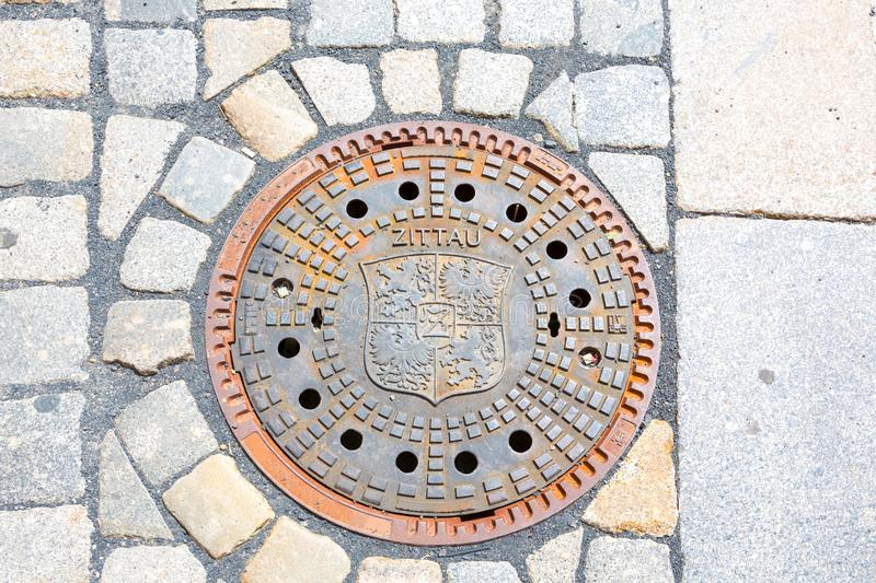 Zittau Coat, manhole covers, Saxony, Germany royalty free stock photos