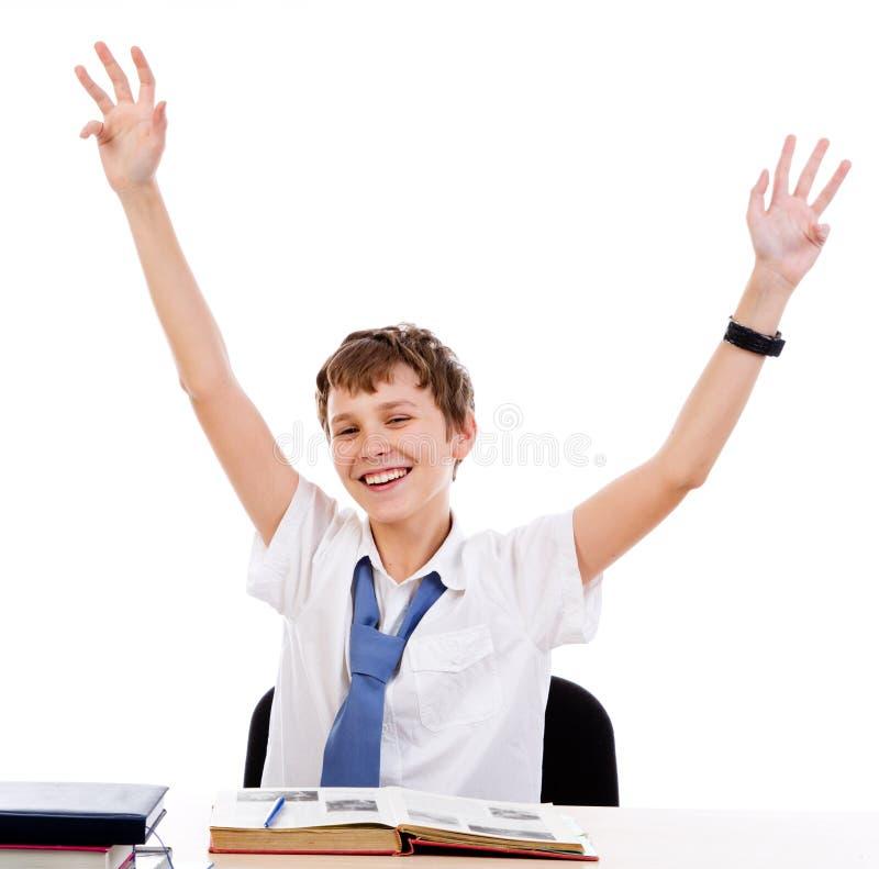 Zittende gelukkige student stock afbeeldingen